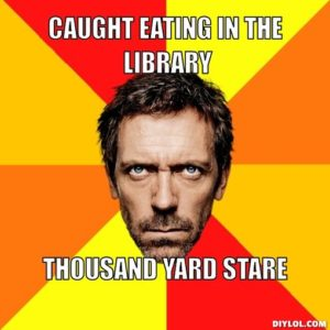 Caught eating in the library, thousand yard stare.